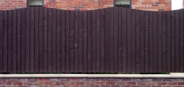 Picture of Black Wood Fence Wood Fence Painted Black With Curved Top Texture